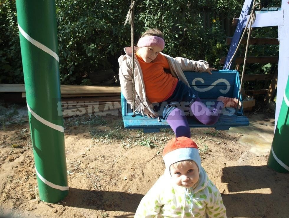 Children's Swing With Their Hands