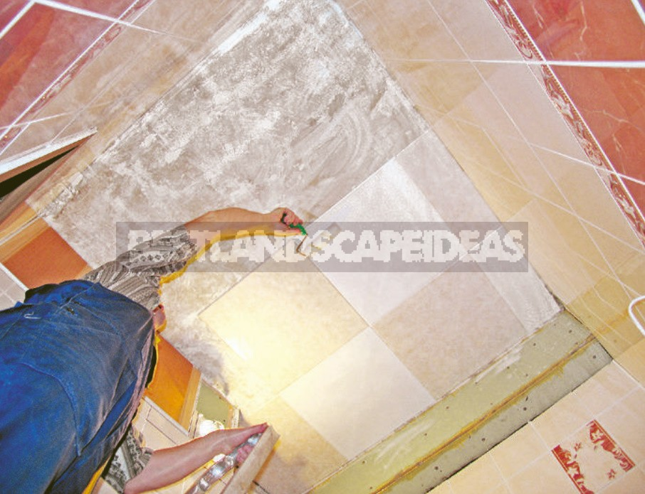 We Glue The Ceiling Tile Made Of Expanded Polystyrene In The Bathroom